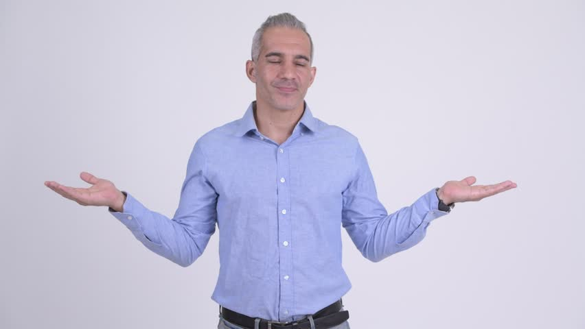 Handsome Persian businessman comparing something against white background | Shutterstock HD Video #1022395558