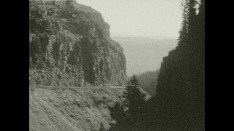 1920s: Sign for Rustic Falls. Water flows over galls. Sign for Obsidian Cliff, elevation 7350.