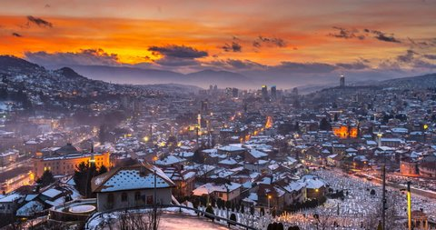Sarajevo skyline aerial view from night to day timelapse at winter Bosnia and Herzegovina snow in sarajevo city timelapse. View of Sarajevo old town and city hall.