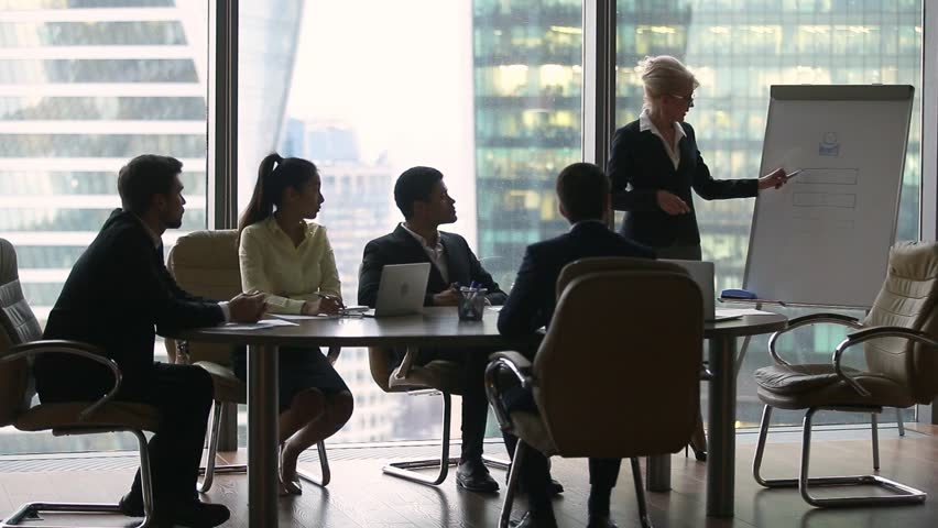 Female executive leader coach presenter giving lecture presentation in modern office boardroom for corporate employees group, speaker mentor explaining training professional team at business seminar | Shutterstock HD Video #1022497318