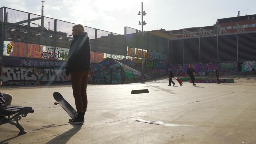 BARCELONA, SPAIN - January 9, 2019. The guys does tricks on a skateboard in a skate park painted with graffiti | Shutterstock HD Video #1022534278