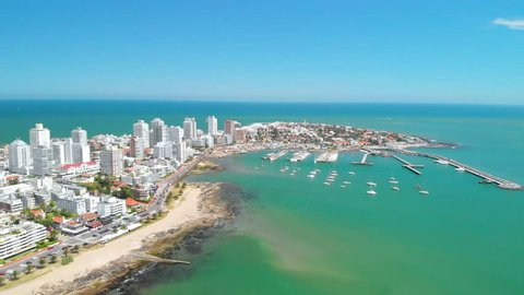 Punta del Este, Uruguay: Flying near downtown with a great view to some buildings and yatches at the port