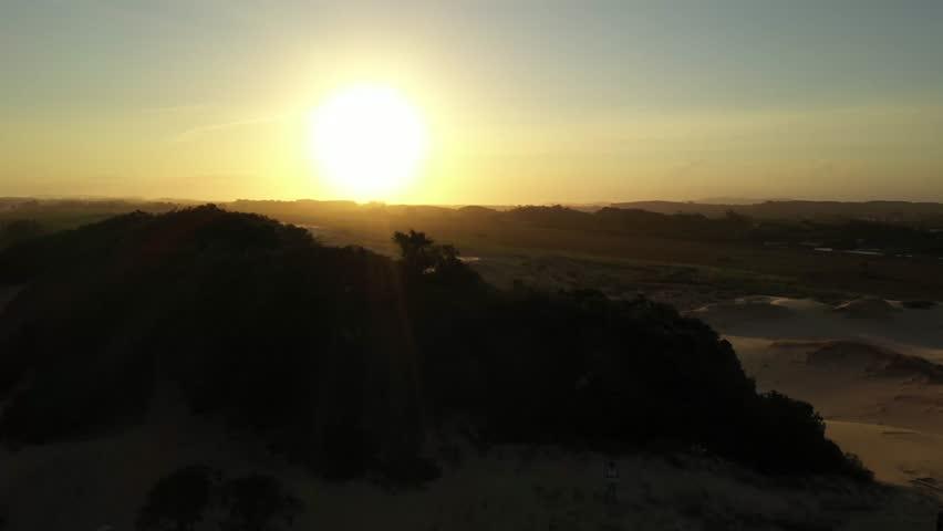 Beautiful sunset aerial image over the dunes of Balneário Rincão - Santa Catarina - Brazil   Shutterstock HD Video #1022569018