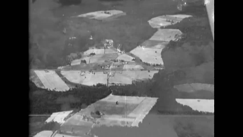 CIRCA 1943 - Aerial footage shot from an SB2C Helldiver shows coastal areas. | Shutterstock HD Video #1022574118