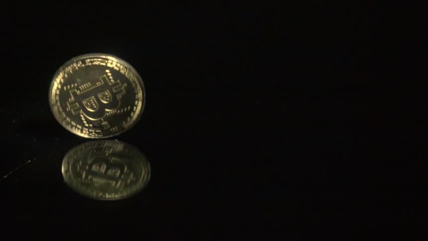 Slowmotion shot tossing bitcoin to flip on heads or tails | Shutterstock HD Video #1022579128