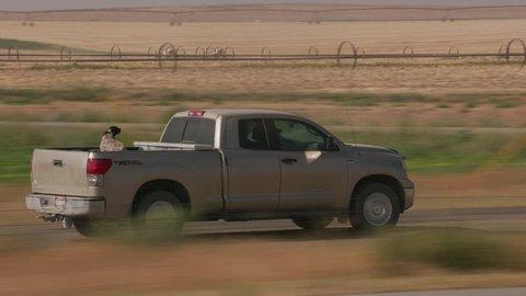 Wyoming circa-2018. Pickup truck driving on rural road