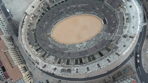Flying over the old Roman amphitheatre in the city of Nimes, France.