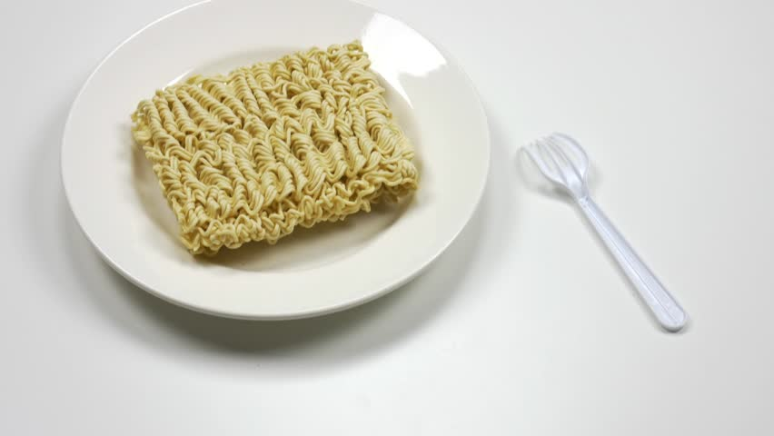 Instant noodles in a plate on a white background. Fast food, junk food, unhealthy food. Rolton. Doshirak | Shutterstock HD Video #1022690848