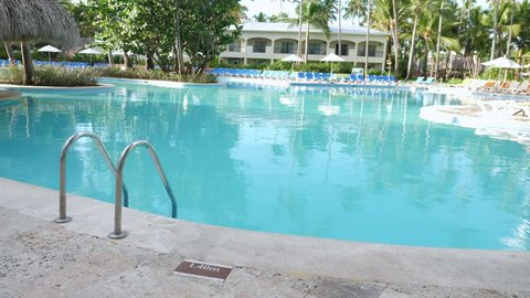 Grab bars ladder in swimming pool at poolside, nobody