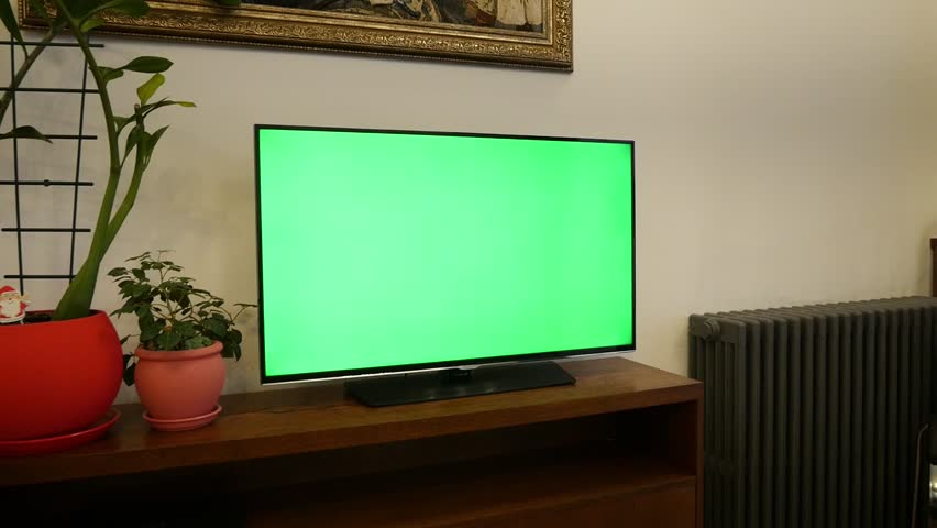 A TV with a green screen in a cozy living room | Shutterstock HD Video #1022740588