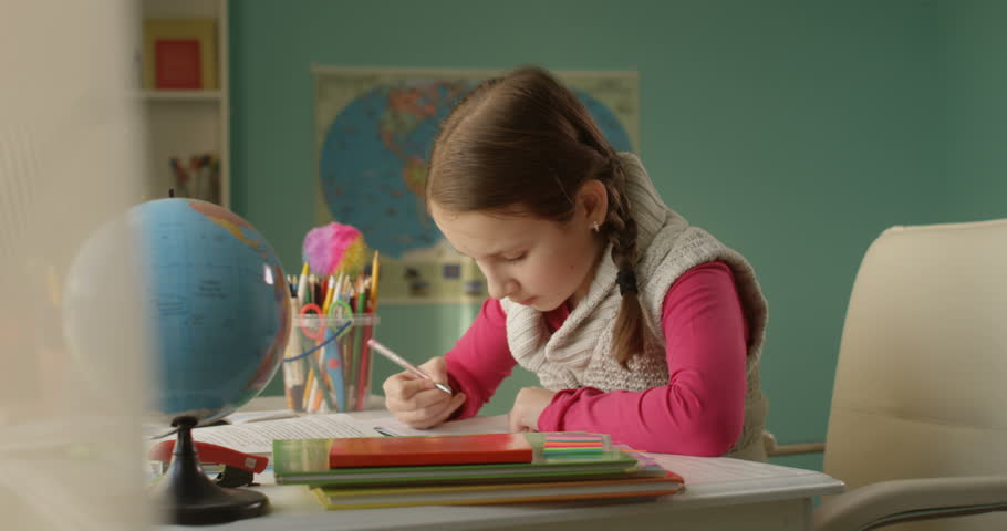 Little School Girl is Doing Homework at the Table at Home on Sunny Day | Shutterstock HD Video #1022760478
