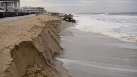 Stormy weather and a violent ocean erodes the sandy beach and dunes away from the Jersey Shore.