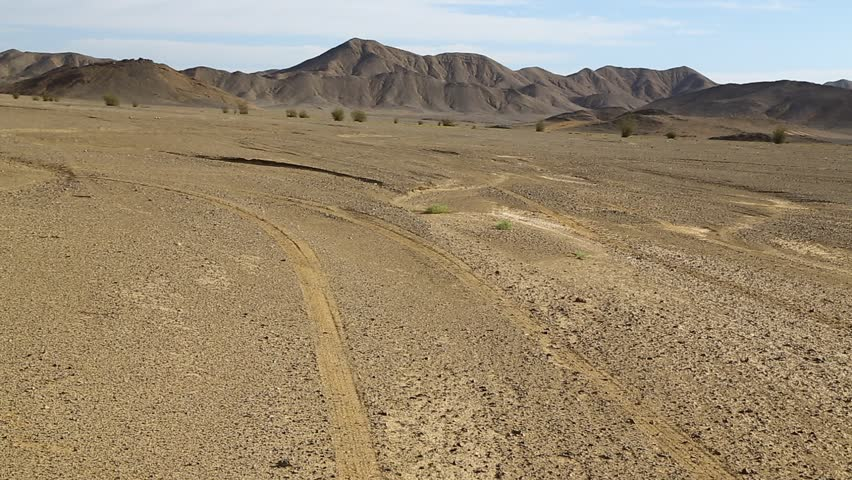 In the middle of the desert rock and track like concept of wild and nature scenic land   | Shutterstock HD Video #1022804848