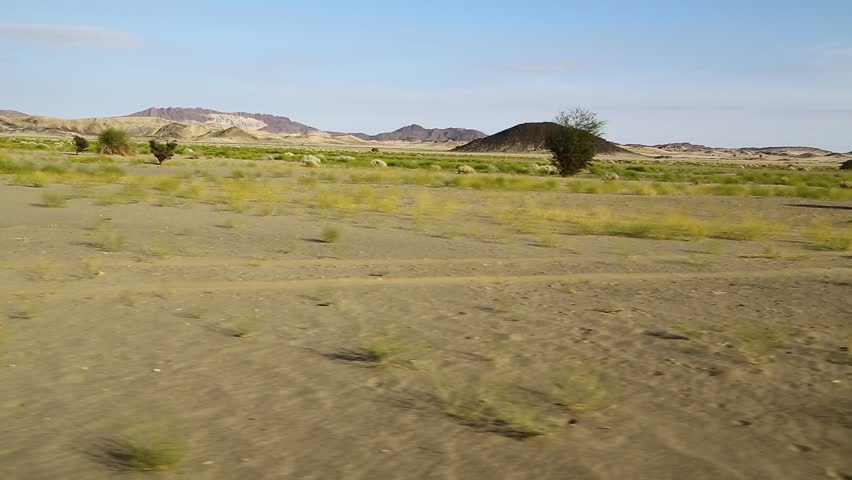 In the middle of the desert rock and track like concept of wild and nature scenic land   | Shutterstock HD Video #1022804938