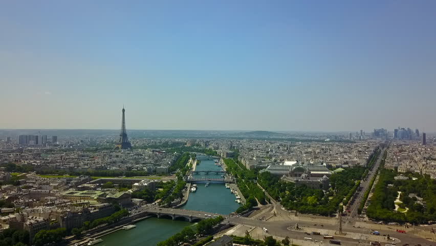 AERIAL: Over Paris Old Town and Park looking towards Eiffel Tower // Summer, Daylight | Shutterstock HD Video #1022811418