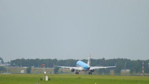 AMSTERDAM, THE NETHERLANDS - JULY 25, 2017: KLM Cityhopper Embraer 190 PH-EXA rotate and departure at runway 36L Polderbaan. Shiphol Airport, Amsterdam, Holland
