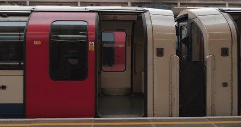 LONDON ENGLAND JANUARY 2019: Overground tube station door closes train closing shut