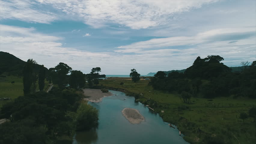 Rising Aerial of Beautiful Blue River Winding Out to Sea. | Shutterstock HD Video #1022846668