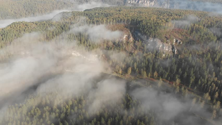 Slow aerial flight backwards over a gentle mountain river, pine forest, clouds. | Shutterstock HD Video #1022858548