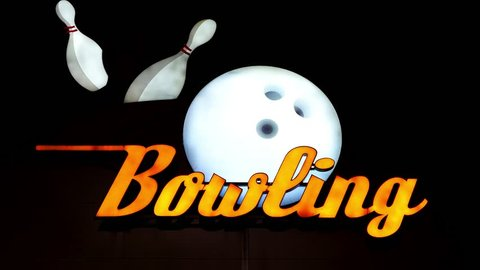 Bowling neon sign with a bowling ball and skittles. Skittle and letter flashes.