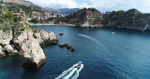 Panoramic aerial view of Cefalu sea port and Tyrrhenian Sea coast, Sicily, Italy. Cefalu city is one of the major tourist attractions in the region. View from Rocca di Cefalu. 4K, 50fps, slowmotion