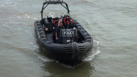 London, United Kingdom (UK) - 07 01 2015: Armed officers on a police counter terrorism boat