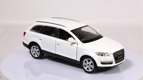BERLIN, GERMANY - JANUARY. 2019: White Audi Q7 scale model suv car is rotating isolated on white background.