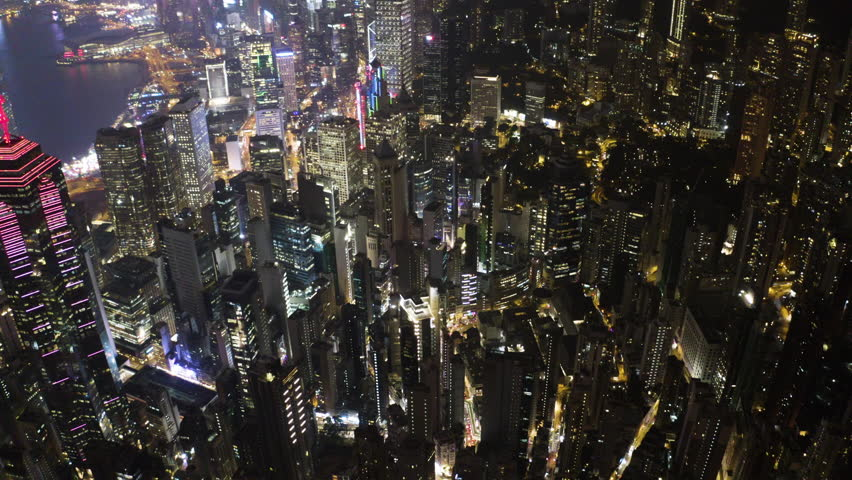 Bird eyes view of Hong Kong cityscape from the drone at night time. Tight aerial forward shot flying over office buildings and skyscrapers. | Shutterstock HD Video #1023070828
