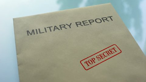 Military report top secret, stamping seal on folder with important documents