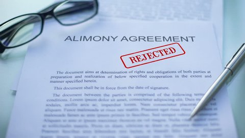 Alimony agreement rejected, officials hand stamping seal on business document