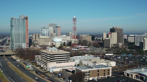 Tysons, VA / USA - December 29 2018: Aerial rise with tilt, tigher shot showing entire Tysons Corner skyline from south across Leesburg Pike