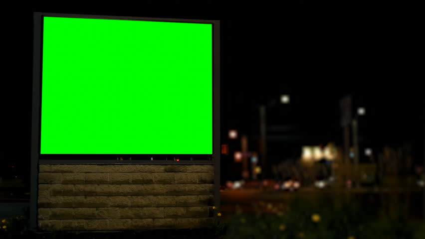 Empty billboard with chroma key green screen at night. Street lights and moving vehicle in the dark  | Shutterstock HD Video #1023148258