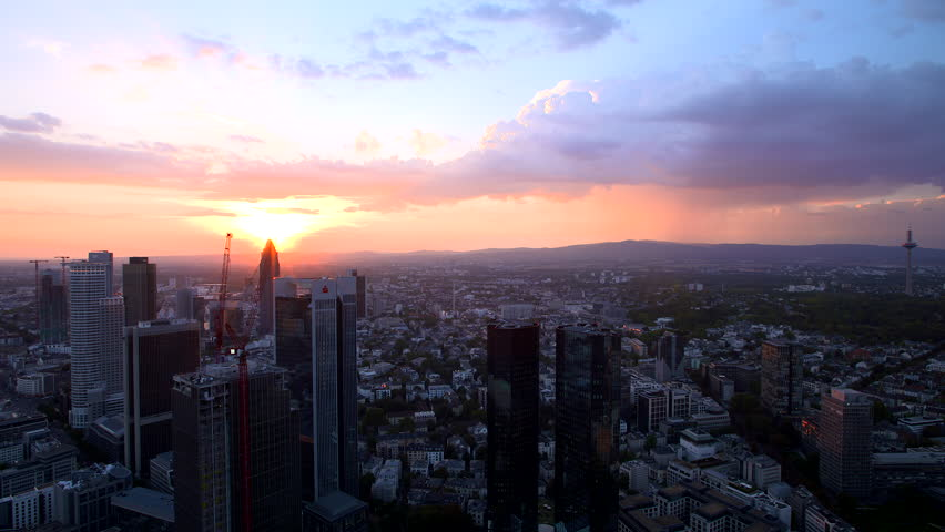 Frankfurt, Hessen / Germany - 09.17.2018 - Cityscape of the finance district at sunset. | Shutterstock HD Video #1023197908