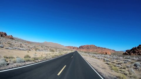 POV road drive trip desert landscape eroded red sandstone Valley of Fire Indian Reservation Nevada USA