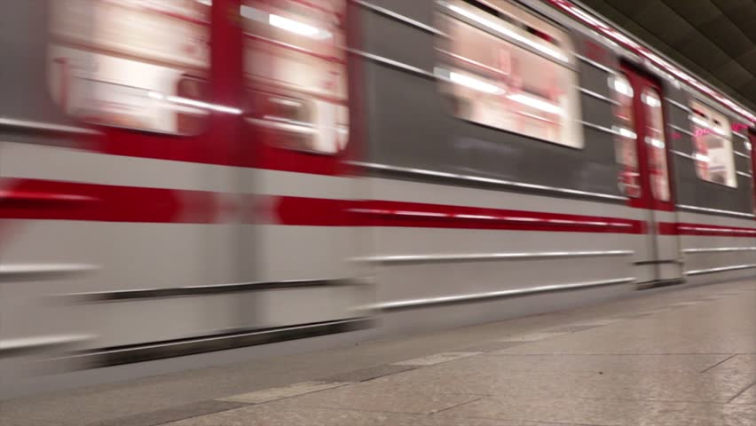 Subway (underground, metro) with red and white stripes arriving at the station. | Shutterstock HD Video #1023231868