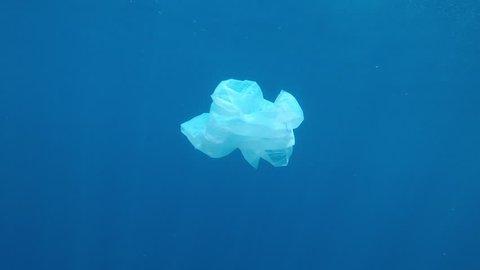 Plastic bag pollution underwater in ocean