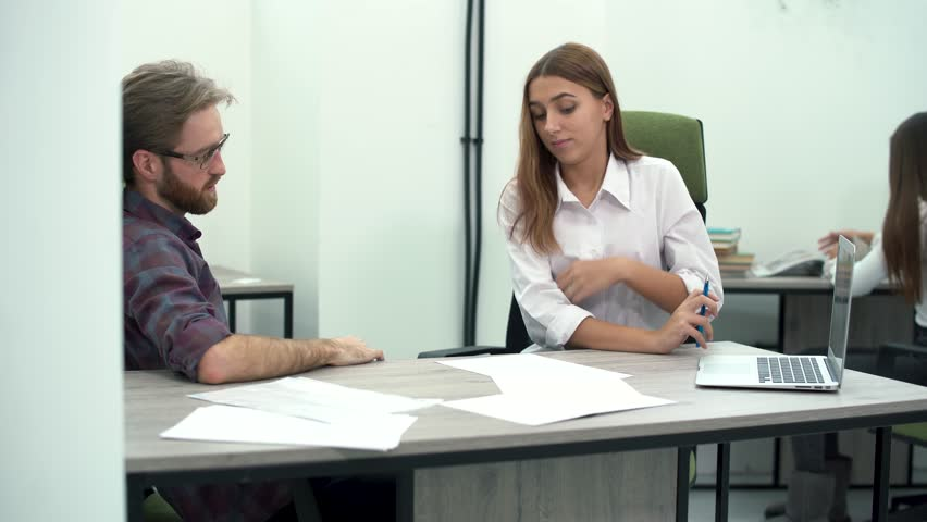 The girl manager shares with the boss new plans for the future and shows a growth strategy on a laptop. Creative business team meeting in modern office. | Shutterstock HD Video #1023289078