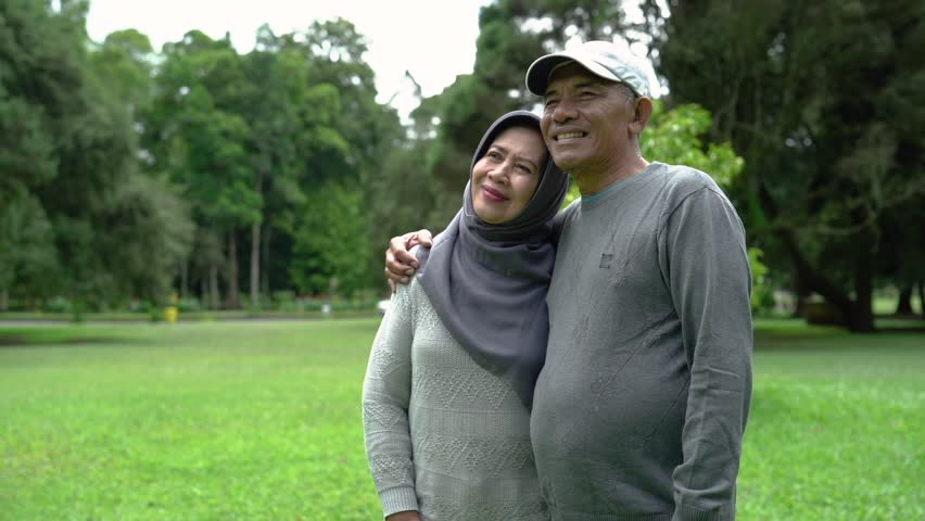 Muslim senior couple having a chat in the park relaxing together | Shutterstock HD Video #1023298618