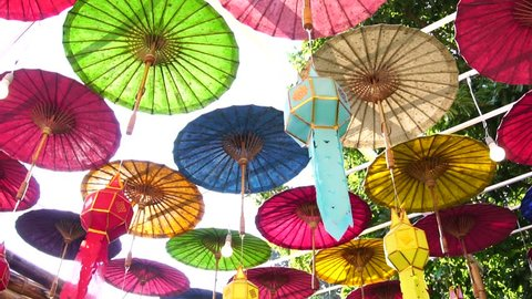 Lanna style, Paper umbrellas multicolored Colorful lamps decorated in Thai temple which is famous tourist attraction in Nan Province Thailand