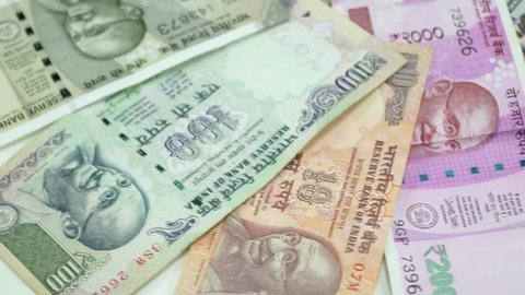India money and US dollar on the rotating table. 4K