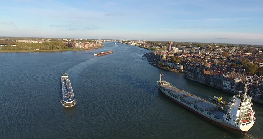 Shipping boats on river, aerial view, Netherlands | Shutterstock HD Video #1023408208