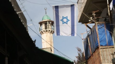 Israel National Flag Hanging With Mosque Minaret In Background