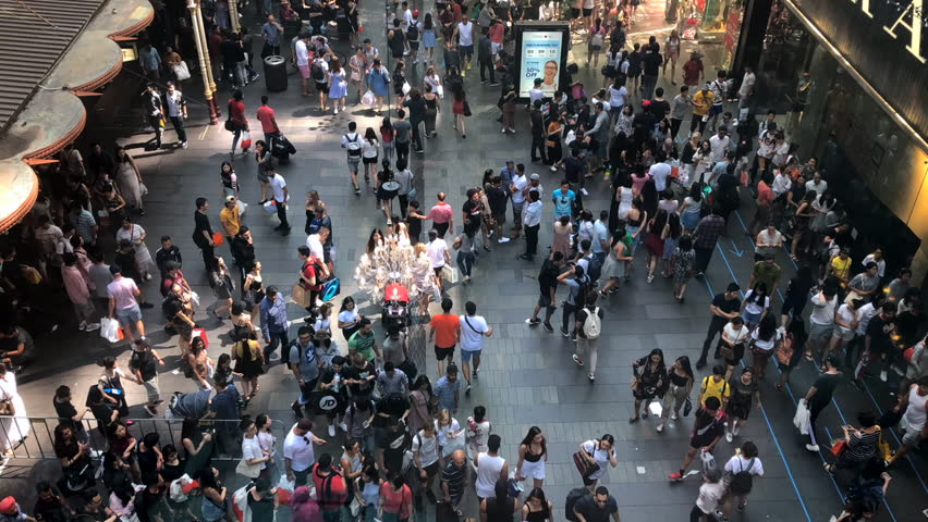 Sydney, Australia, December 2018: Time lapse of Crowds of People  walking through Sydney streets on a Boxing day #1023463258
