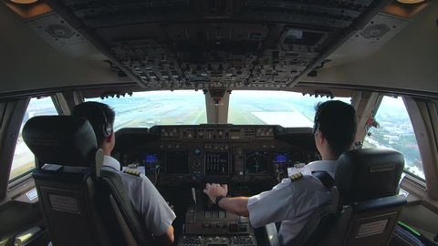 cockpit view of airline pilot control aircraft in daytime,commercial pilot landing the aircraft ,4K footage