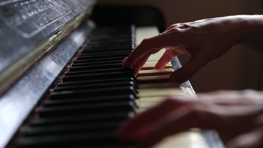 Close up fingers of woman pianist at the rusty piano keys, arms plays solo of music. Hands of female musician playing.  #1023498658