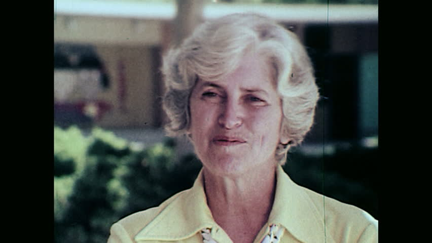 1970s: UNITED STATES: Caucasian lady talks to camera. Asian lady talks to camera. | Shutterstock HD Video #1023529678