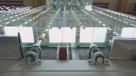 glass for double glazed windows moves on the machine in production. manufacture of glass for double glazed windows