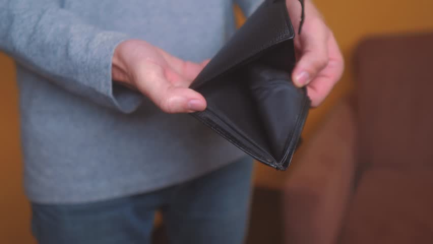 Man bankrupt arrears showing empty wallet with no money. poverty Finance business bankruptcy concept. male debt businessman showing empty wallet. crisis of getting into debt. no money on payments | Shutterstock HD Video #1023549268
