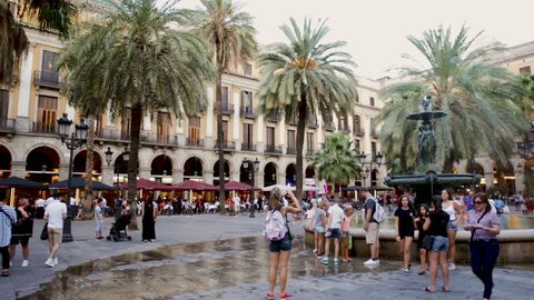 BARCELONA, SPAIN - AUGUST 21, 2018:  Evening view of Placa Reial in summer. Barcelona, Catalonia
