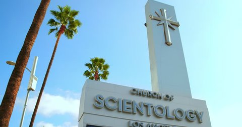 LOS ANGELES, CALIFORNIA - NOVEMBER 24, 2018: Church of Scientology digital advertising billboard on Sunset Boulevard in Hollywood, Los Angeles California, 4K